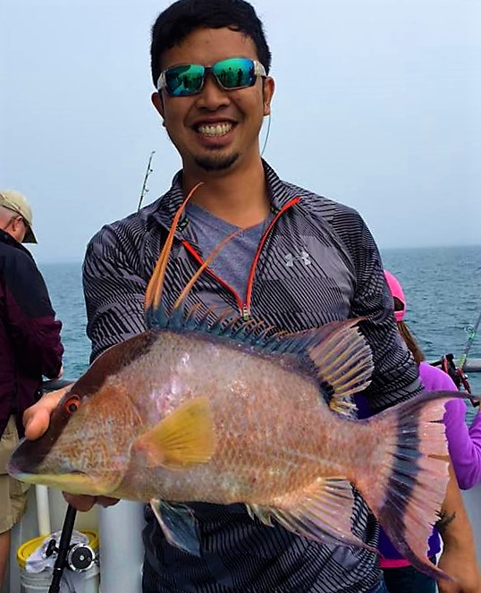 Ananthachai Nantakul from Tampa showing off a big all day hogfish from the 10 hour deep sea fishing trip at Hubbard's Marina
