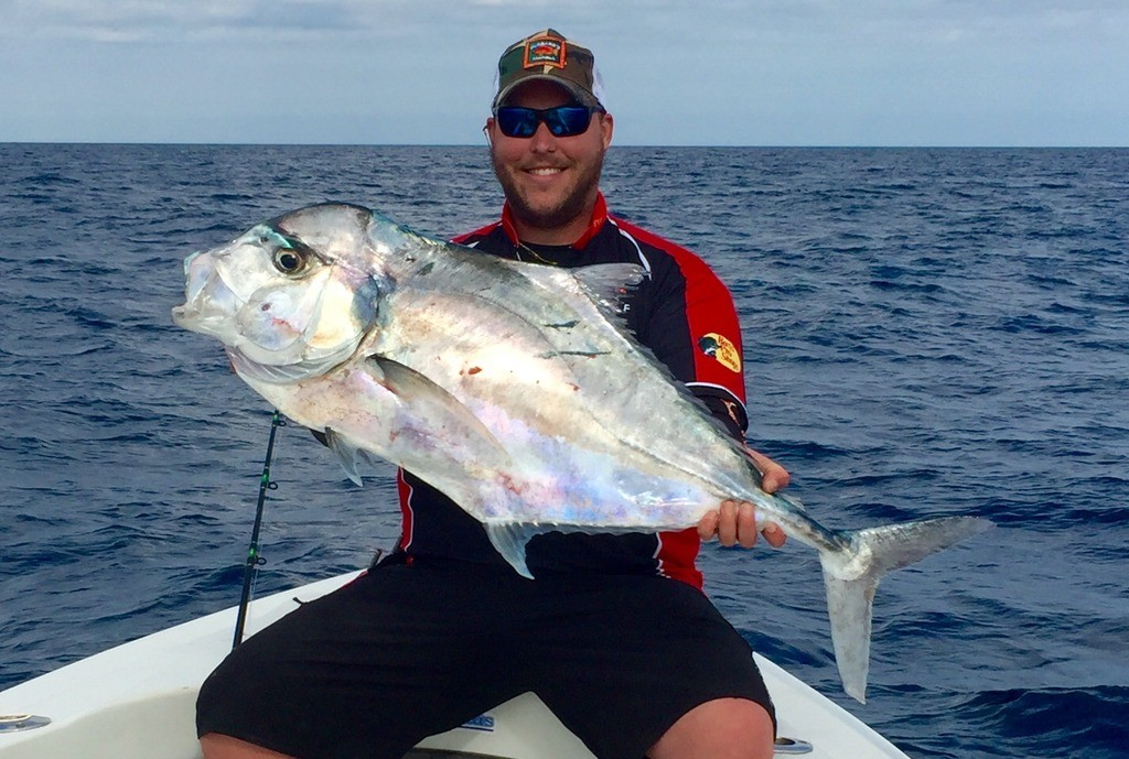 Dylan Hubbard showing off a monster african pompano from a recent Flying HUB private charter at Hubbard's Marina