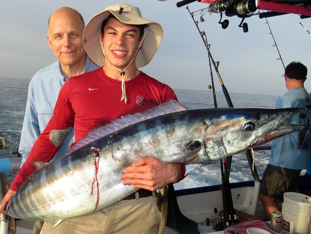 Left-Right- Guy Peterson and Alex Sandoval showing off the 55lb wahoo they caught during the 39 hour at Hubbard's trolling off our party boat