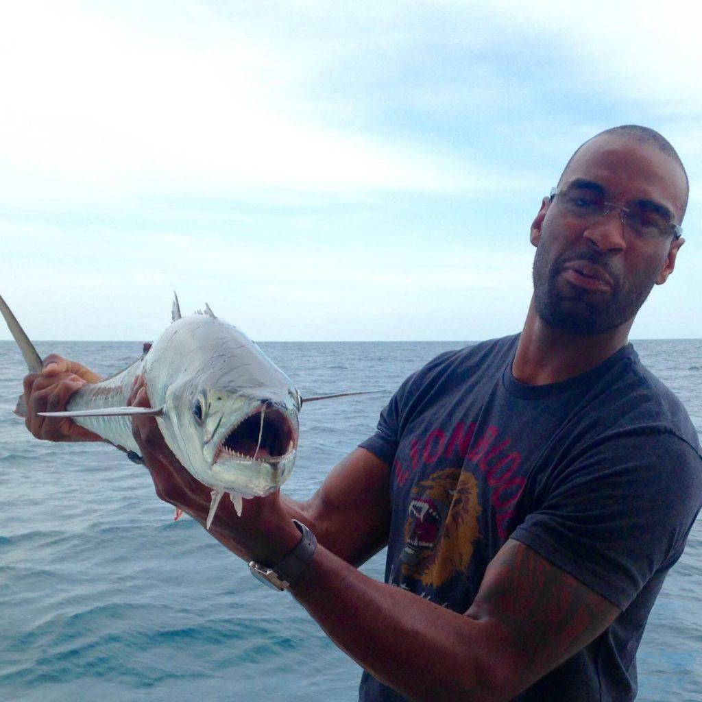 Calvin Johnson Jr. 'Megatron' showing off a kingfish he caguht while private charter fishing on the Mrs. HUB at Hubbard's Marina