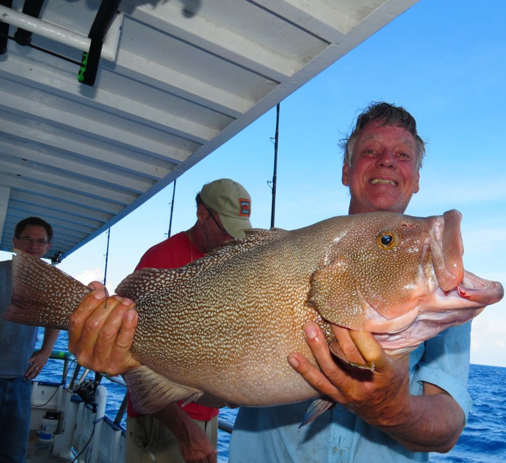 Keith Underwood showing off his monster kitty Mitchell grouper from the long range deep sea fishing trip at Hubbard's Marina