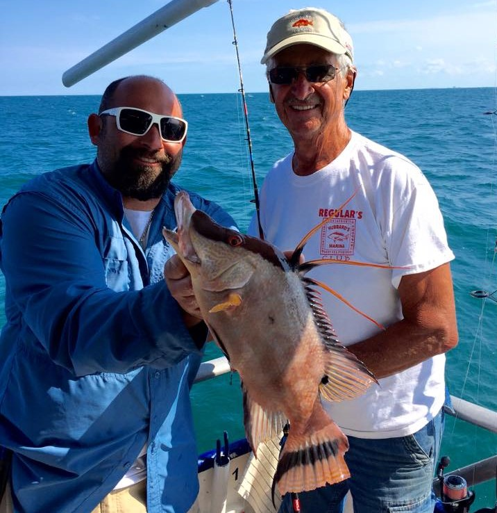 Left-Right- Captain Frank and Bill Stringer showing off bill's beautiful hogfsih from a 5 hour half day at Hubbard's Marina